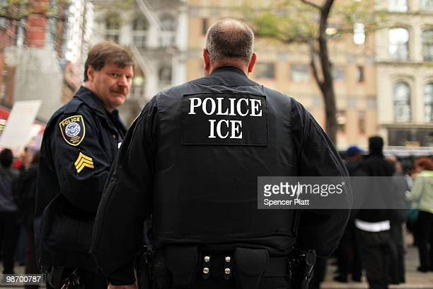 Police and members of Immigration and Customs Enforcement keep watch over a rally in support of illegal immigrants on April 27 2010 outside of...