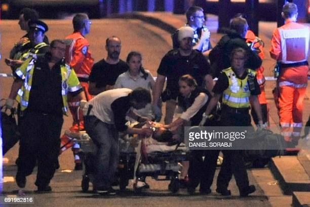TOPSHOT Police and members of the emergency services attend to victims of a terror attack on London Bridge in central London on June 3 2017 Armed...