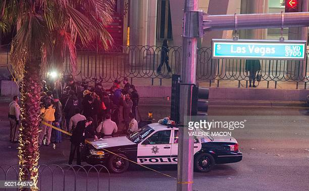 TOPSHOT Police and members of the media are pictured along part of the Las Vegas Strip after a car ran into a group of pedestrians between Planet...