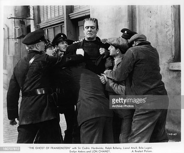 Police and men surrounding monster Lon Chaney Jr in a scene from the film 'The Ghost Of Frankenstein' 1942