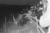 Police and miners crash though a fence and tumble down an embankment in a violent clash during the UK Miners' strike 16th March 1984