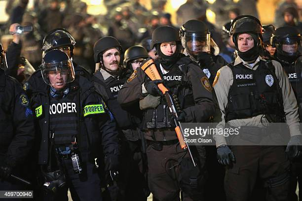 Police and national guard tconfront demonstrators outside the police station November 28 2014 in Ferguson Missouri The Ferguson area has been...
