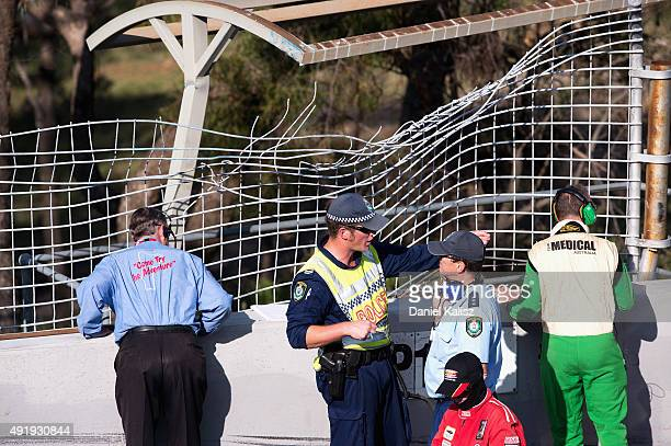 Police and Officials can be seen inspecting the impact point where the car of Chaz Mostert driver of the Pepsi Max Crew PRA Ford FG X Falcon crashed...
