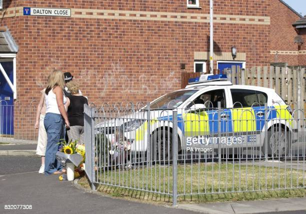 Police and passersby at the junction of Dalton Close and Billinge Street in Blackburn Lancashire where a sixyearold girl was killed in a hitandrun...