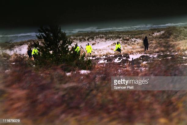 Police and police recruits search an area of beach near where police recently found human remains on April 5 2011 in Babylon New York Working on the...