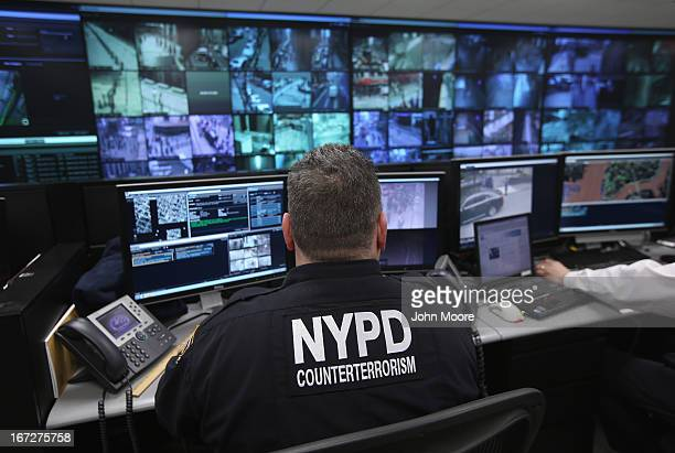 Police and private security personel monitor security cameras at the Lower Manhattan Security Initiative on April 23 2013 in New York City At the...