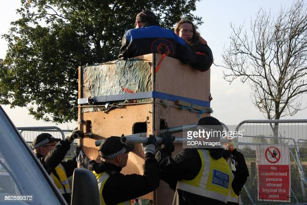 Police and Protestor Removal Teams attempting a variety of tactics to remove two AntFracking protestors who have locked themselves onto a wooden...