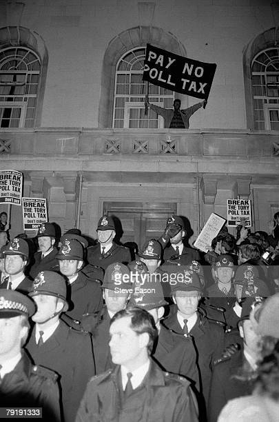 Police and protestors at a demonstration against the Poll Tax in Hackney London 8th March 1990
