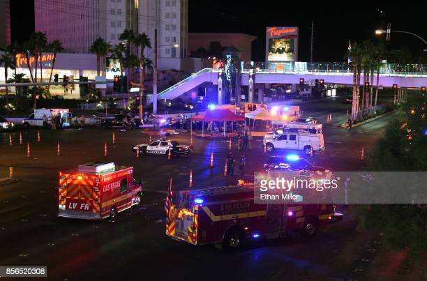 Police and rescue personnel gather at the intersection of Las Vegas Boulevard and Tropicana Ave after a reported mass shooting at a country music...