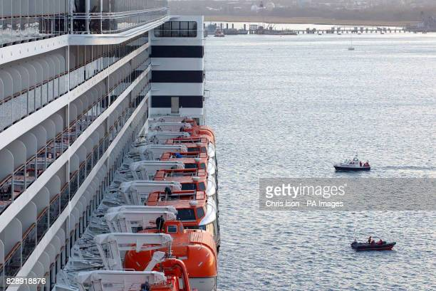 Police and security boats circle the new Cunard Liner Queen Mary 2 in Southampton where the vessel the biggest ever built at almost three times the...