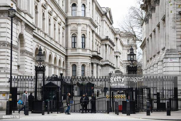 Police and security forces stand guard at the gates of Downing Street ahead of the weekly Prime Minister's Questions session in the House of Commons...