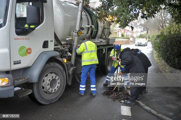 Police and SITA workers open and inspect drains in the area around Canynge Road Clifton Bristol in the ongoing murder investigation into Joanna Yeates