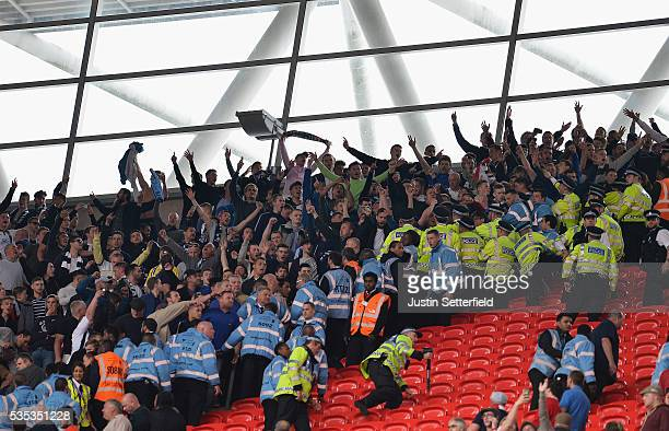 Police and stewards hold back Millwall fans during the Sky Bet League One Play Off Final between Barnsley and Millwall at Wembley Stadium on May 29...