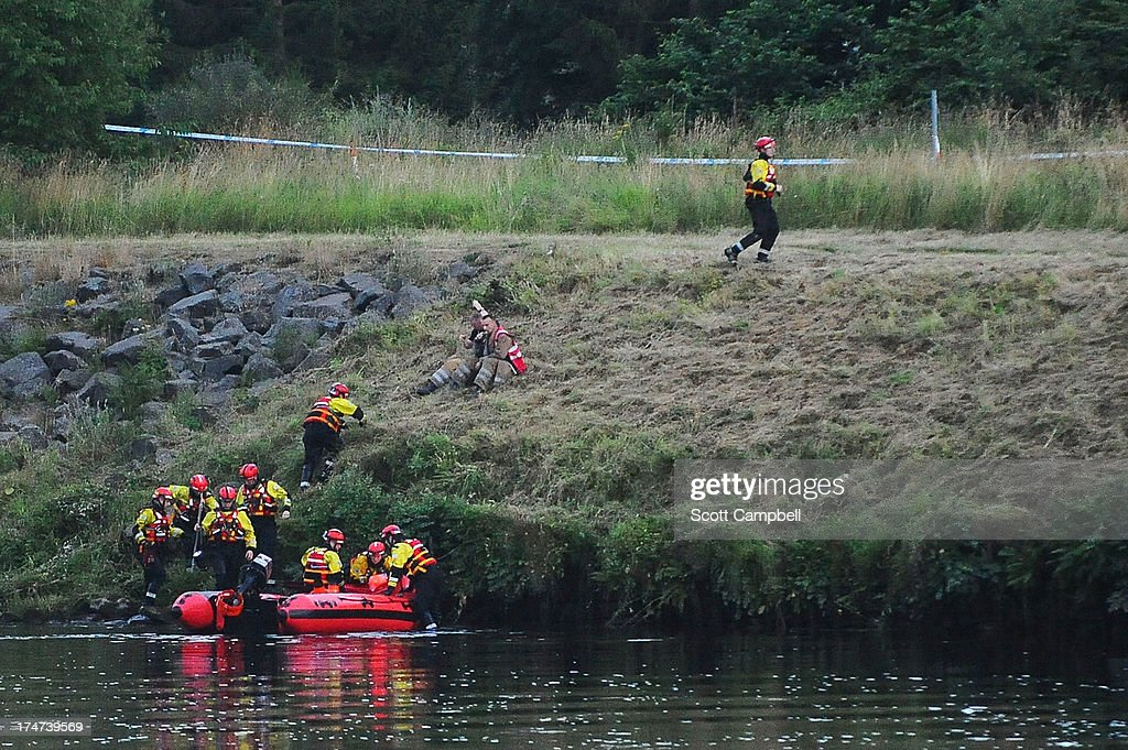 Police and Tayside Fire and Rescue Services search the River Tay after a 16 year-old boy was reported missing on July 28, 2013 in Perth, Scotland. The boy is understood to have gone missing after experiencing difficulties attempting a crossing near North Muirton early in the evening.