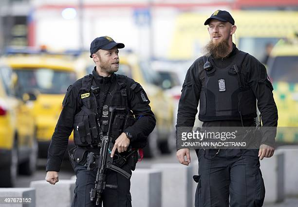 Police are pictured outside terminal 3 at Kastrup airport in Copenhagen on November 18 2015 Danish police evacuated one of two terminals at...