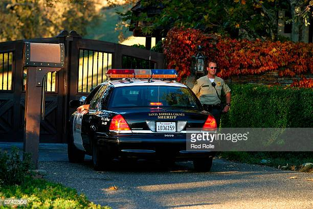 Police are seen at Michael Jackson's Neverland ranch on November 18 2003 in Santa Ynez California 6080 investigators from the Santa Barbara County...