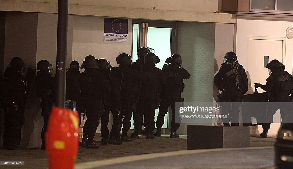 Police are seen during an operation in the 'CroixRouge' suburb of Reims northern France early January 8 2015 following the attack on satirical weekly...