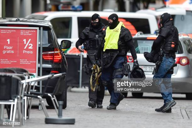 Police are seen in the old quarter of Schaffhausen northern Switzerland where a man armed with a chainsaw injured at least five people in an attack...