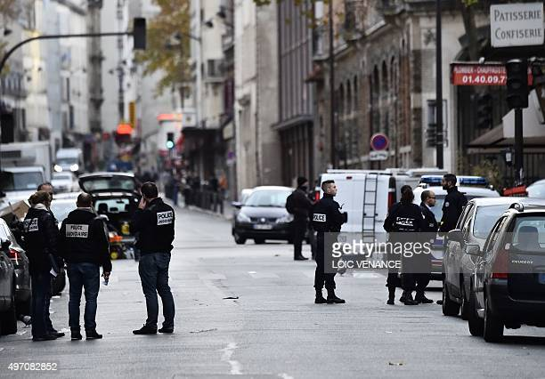 Police are seen near the Cafe La Belle Equipe at the Rue de Charonne in Paris on November 14 following a series of coordinated attacks in and around...