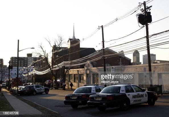 Police are seen near the scene of Whitney Houston's funeral at New Hope Baptist Church on February 18 2012 in Newark New Jersey Whitney Houston was...