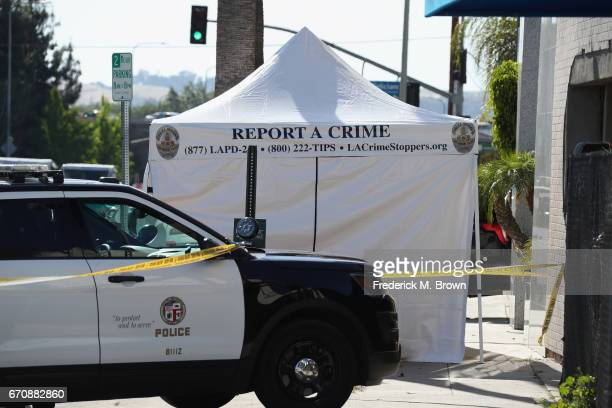 Police are seen near the site where singer Cuba Gooding Sr was found dead in his car on April 20 2017 in Woodland Hills California Gooding was 72...