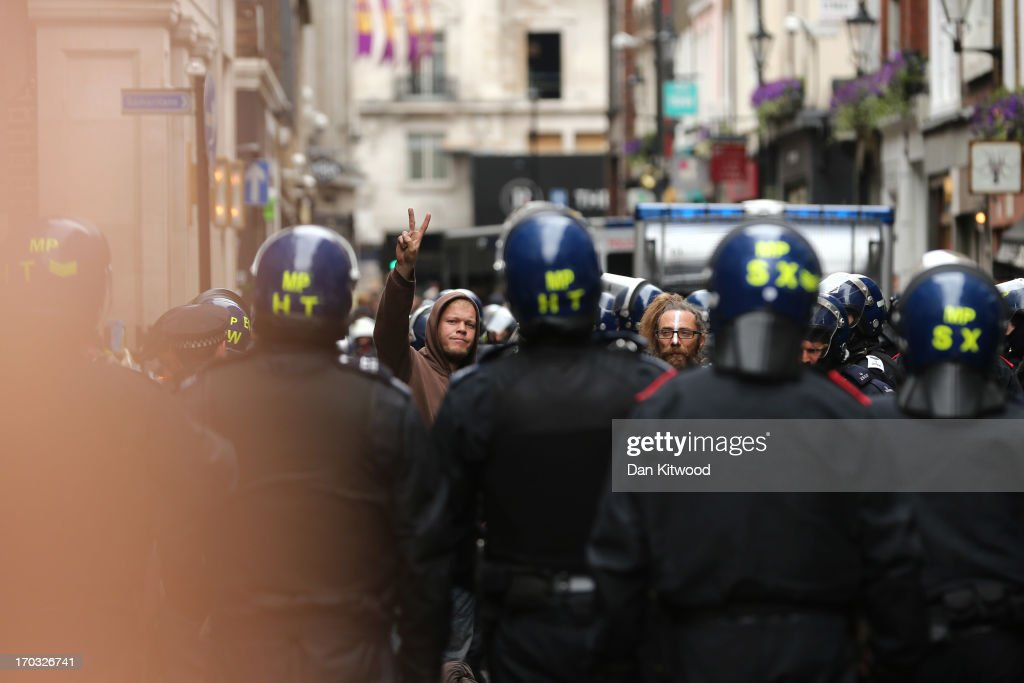 Police are seen on Beak Street as arrests are reportedly made as activists occupy a convergence centre of the Stop G8 protest group off Beak Street ahead of next week's G8 summit in Northern Ireland on June 11, 2013 in London, England. Next week will see Enniskillen in Northern Ireland host the two day G8 summit where international leaders including Britain's Prime Minister David Cameron and US President Barack Obama take part in the two day event. The chosen location is only 8 kilometers from the scene of one of Northern Ireland's worst killings back in 1987, however Cameron is confident that it's secluded location will deter any potential trouble.