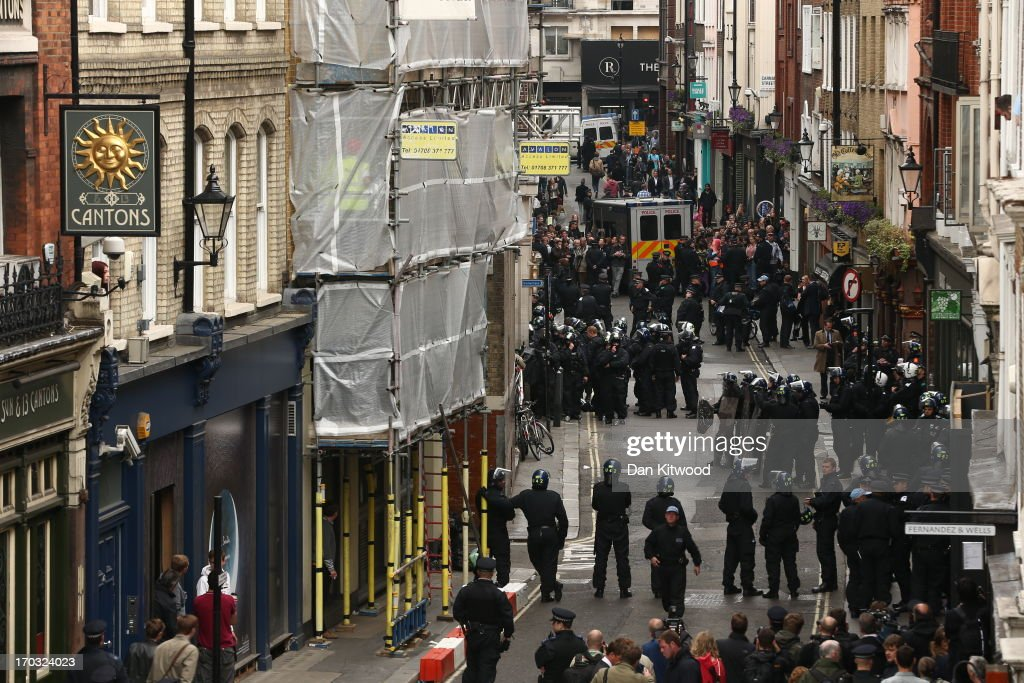 Police are seen on Beak Street to diffuse anti G8 protesters potentially becoming violent, as they reportedly occupy a Police Station ahead of next week's G8 summit in Northern Ireland on June 11, 2013 in London, England. Next week will see Enniskillen in Northern Ireland host the two day G8 summit where international leaders including Britain's Prime Minister David Cameron and US President Barack Obama take part in the two day event. The chosen location is only 8 kilometers from the scene of one of Northern Ireland's worst killings back in 1987, however Cameron is confident that it's secluded location will deter any potential trouble.
