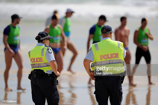 Police are seen on the beach during the Australian Surf Lifesaving Championships at North Kirra beach on March 30 2012 on the Gold Coast Australia