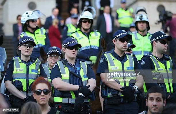 Police are seen on the steps of the Victorian Parliament on May 21 2014 in Melbourne Australia Student activists gathered today in cities accross the...