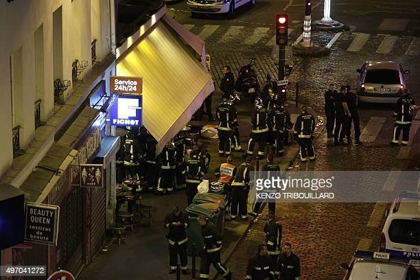 Police are seen outside a restaurant in 10th arrondissement of the French capital Paris on November 13 2015 At least 18 people were killed as...