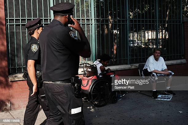 Police are viewed in an area which has witnessed an explosion in the use of K2 or 'Spice' a synthetic marijuana drug in East Harlem on September 16...