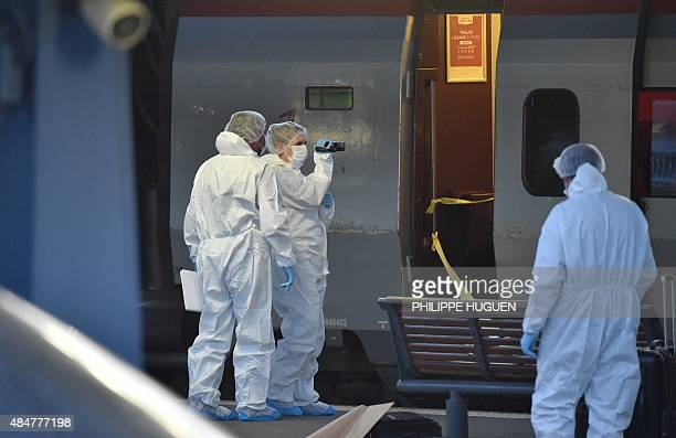 Police arive to inspect the crime scene inside a Thalys train of French national railway operator SNCF at the main train station in Arras northern...