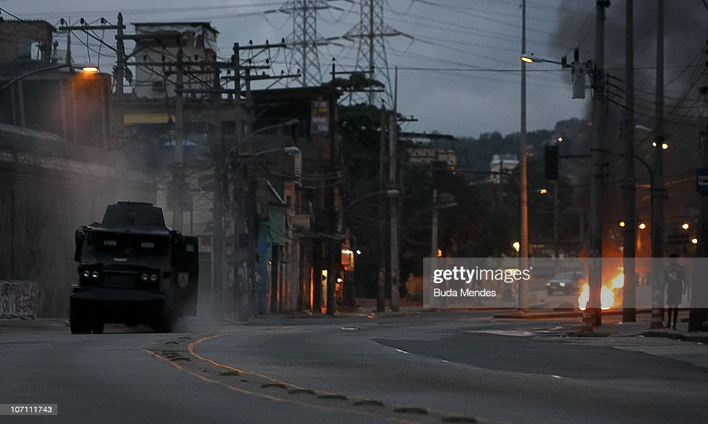 Police armored vehicle Caveirao stops after being attacked with a grenade by members of the criminal organizations ADA and Comando Vermelho at Favela...