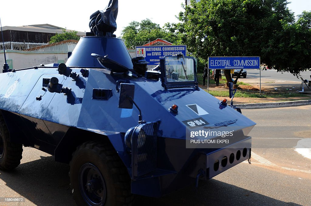 A Police armoured car patrols on the main road to the Electoral Commission's headquarters before the announcement of the results of the presidential...