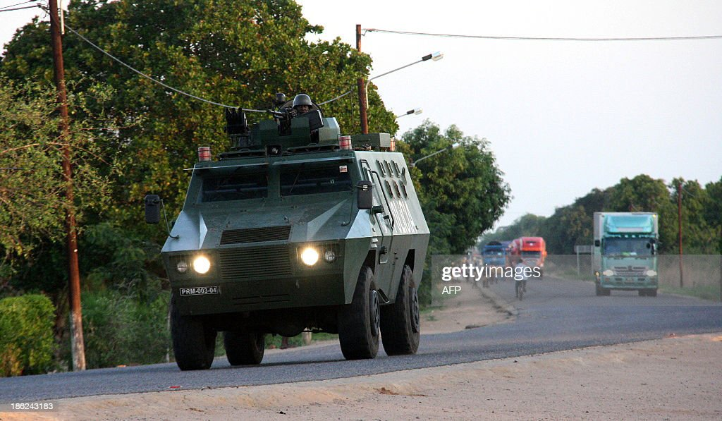 A police armoured vehicle escorts commercial trucks traveling from Muxungue in Sofala province on October 29 2013 Mozambique troops have seized a...