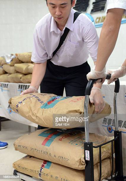 Police arrange bags of seized ketamine at the Criminal Investigation Bureau during a press conference in Taipei on May 9 2013 Taiwanese police said...