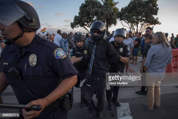 Police arrest a Conservative demonstrator at an 'America First' demonstration on August 20 2017 in Laguna Beach California Organizers of the rally...
