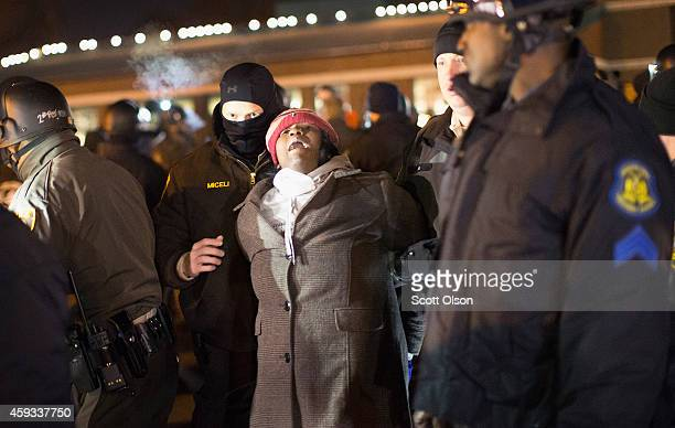 Police arrest a demonstrator protesting the shooting death of 18yearold Michael Brown outside the police station on November 20 2014 in Ferguson...