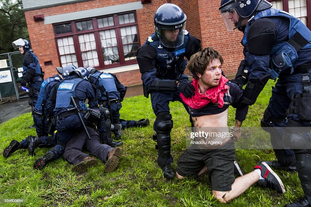 Police arrest a man as three officers push another to the ground during a 'Say No To Racism' protest and a counter 'Stop the Far Left' rally in Coburg Melbourne, Australia on May 28, 2016. Seven men were arrested after a violent brawl erupted between rival protesters at an anti-racism rally in Melbourne's inner-north. Anti-Facists clashed with Anti-Islam nationalists who go by the name 'True Blue Crew'.