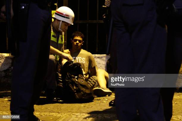 Police arrest a protester against the decision of a Brazilian judge who approved gay conversion therapy in Sao Paulo Brazil on September 22 2017...