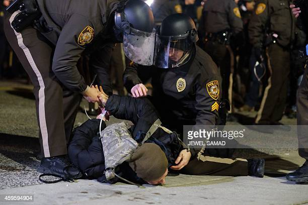 Police arrest a protester in Ferguson Missouri on November 25 2014 during demonstrations a day after violent protests and looting following the grand...