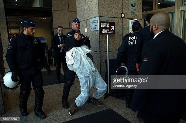 Police arrest activists after their attempt to enter the EU building as they take part in protests against the Comprehensive Economic and Trade...