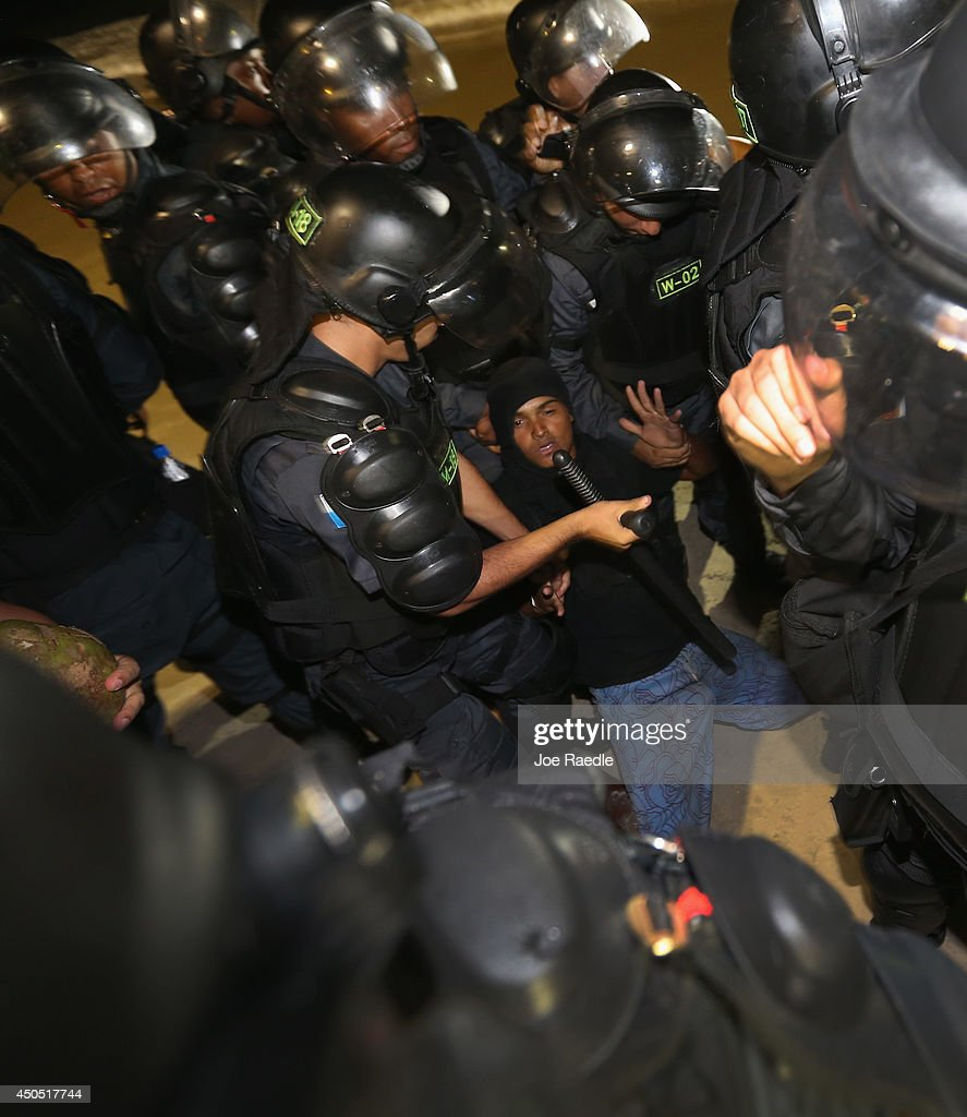 Police arrest an anti-World Cup protester during a march on Copacabana beach on June 12, 2014 in Rio de Janeiro, Brazil. Brazil defeated Croatia 3-1 in the first match of 2014 FIFA World Cup today.