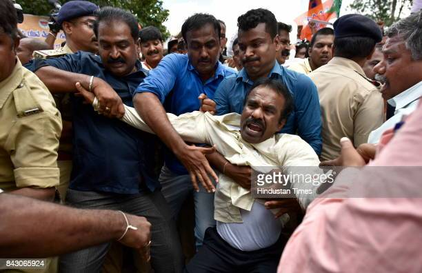 Police arrest BJP supporters as they were about to start Mangalore Chalo Bike rally from Freedom Park on September 5 2017 in Bengaluru India The BJP...