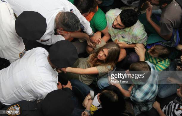 Police arrest demonstrators affiliated with the Occupy Wall Street movement after they attempted to cross the Brooklyn Bridge on the motorway on...