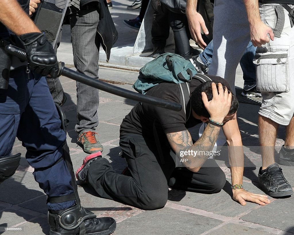Police arrest protesters in Heraklion on the southern Greek island of Crete on October 28, 2012 during a student parade marking the annual celebrations of the National No Day, commemorating Greece's refusal to surrended to Italian dictator Benito Mussolini's invading troops in 1940. AFP PHOTO/ Costas Metaxakis