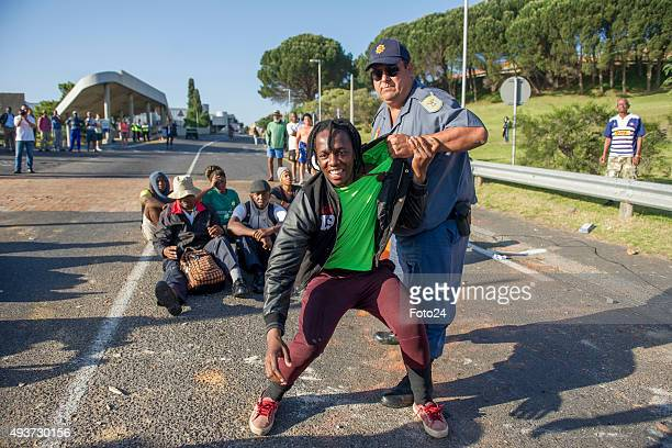 Police arrest UCT students during a protest over an increase on the tuition fees on October 20 2015 in Cape Town South Africa A number of students...