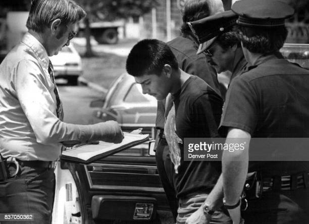 Police Arrest Youth David Trujillo of 4664 Clayton St is taken from a police car outside the Lincoln Cut Rate Market at 1704 E 25th Ave where a youth...