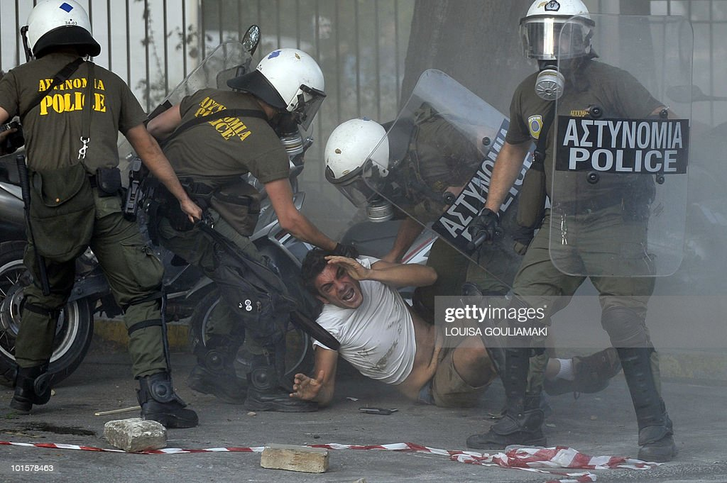 Police arrests a protestor amid tear gas during a pro-Palestine demonstration outside theIsraeli embassy in Athens on May 31, 29010. More than 10 people were killed by Israeli commandos when they stormed a ship which was part of a flotilla of six ships carrying 1,000 tonnes of aid from Cyprus to the Gaza Strip, Palestine. The military strike happened about 40 miles (64 km) out to sea, in international waters.Israel says its soldiers were shot at and attacked with weapons, the activists onboard the aid ship say Israeli troops came on board shooting. Around 600 activists onboard the ships were attempting to defy a blockade imposed by Israel after Political party Hamas took power in Gaza in 2007.