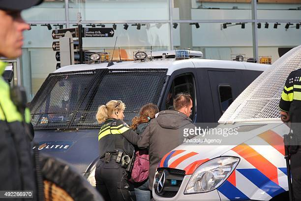 Police arrests a woman as supporters of the Pegida movement argue with the police officers as they stage protest in Utrecht The Netherlands on...